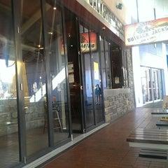 Photo taken at Outback Jacks Bar & Grill by Yavuz B. on 8/10/2013