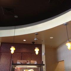 Photo taken at Starbucks by Kei Y. on 12/6/2012