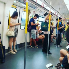 Photo taken at MTR Kowloon Bay Station 九龍灣站 by Felix N. on 9/27/2015
