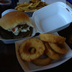 Photo taken at Out of the Park Burgers by Annette Z. on 3/23/2013
