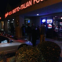 Photo taken at Filippi's Pizza Grotto by Jeff S. on 1/6/2014