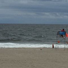 Photo taken at Rockaway Beach by Jan B. on 9/12/2015