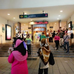 Photo taken at Tampines MRT Station (EW2/DT32) by Stephanie O. on 7/26/2013