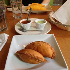 Photo taken at Empanada Mama by Jen J. on 5/10/2013