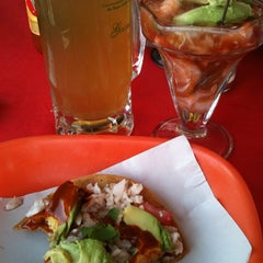 Photo taken at Marisqueria Playa Azul by Erika G. on 2/22/2014