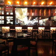 Photo taken at Table 10 by Emeril Lagasse by Ray W. on 4/12/2013