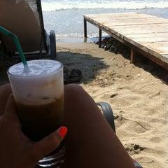 Photo taken at Παραλία Κινίου (Kini Beach) by Xristina S. on 7/6/2013