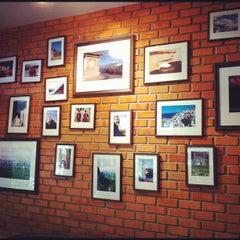 Photo taken at ESCAPE Bistro & Café by tomz365 C. on 11/26/2012