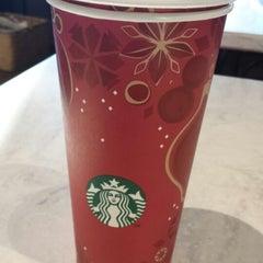 Photo taken at Starbucks by valerie o. on 12/22/2013