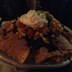 Photo taken at Zafra Cuban Restaurant & Rum Bar by Jennifer M. on 3/9/2014