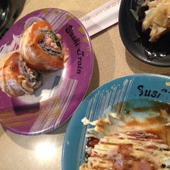 Photo taken at Sushi Train by KoonNineNan on 5/31/2015