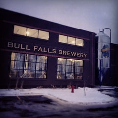Photo taken at Bull Falls Brewery by Anna Z. on 12/12/2014