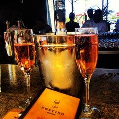 Photo taken at Postino Winecafé by Stephanie B. on 10/19/2012