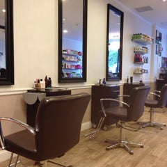 Photo taken at Numi & Company Hair Salon by Magda G. on 9/24/2013