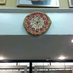 Photo taken at Manny & Olga's Pizza by Ashley R. on 12/2/2011