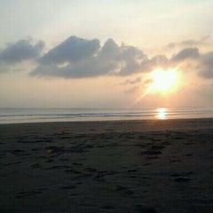 Photo taken at Pantai Barat Pangandaran by Sylvania M. on 8/15/2011