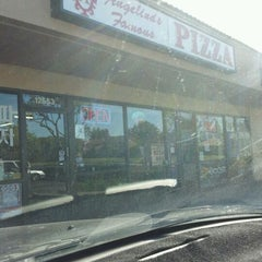 Photo taken at Angelina's Famous Pizza by Jaclyn A. on 1/25/2012