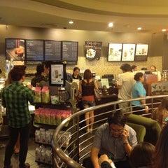 Photo taken at Starbucks (สตาร์บัคส์) by NongNou on 7/18/2012