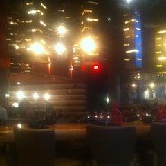 Photo taken at Steel Restaurant & Lounge by Tyler B. on 7/21/2011