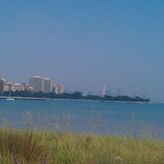 Photo taken at 63rd Street Beach by Elisha V. on 8/25/2012