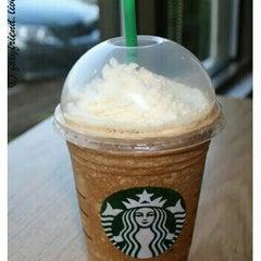 Photo taken at Starbucks by Lyudmila G. on 5/6/2013