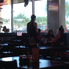 Photo taken at Tailgaters Sports Bar and Grill - Ilprimo Pizza and Wings by Wendy A. on 7/17/2014
