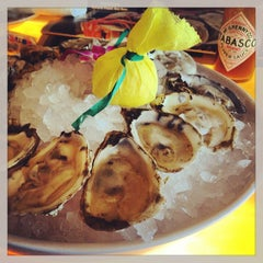 Photo taken at Captain George's Seafood Restaurant by Molly M. on 6/22/2013