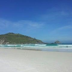 Photo taken at Praia Grande by 💀Bruno F. on 3/13/2013