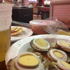 Photo taken at Faidley's Seafood & Fresh Fish Market by Bew R. on 10/27/2012