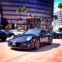 Photo taken at Beverly Hills Porsche Showroom by JayChan on 3/4/2014