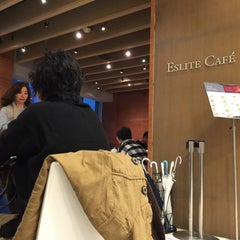 Photo taken at Eslite Café by Lawky on 2/8/2015