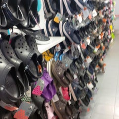 Photo taken at Crocs Store by Gautier R. on 9/22/2013