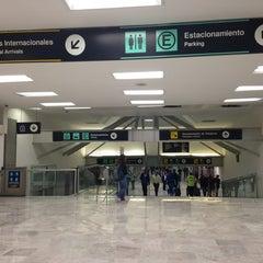 Photo taken at Aeropuerto Internacional de la Ciudad de México (MEX) by Claudia G. on 10/11/2013