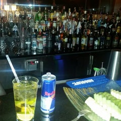 Photo taken at Conrad Roof Bar by Metin E. on 4/17/2015