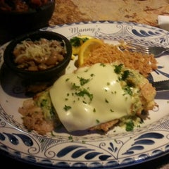 Photo taken at Manny's Cocina by Robyn T. on 8/17/2013