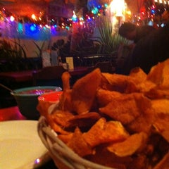 Photo taken at Atomic Cafe by Elizabeth F. on 12/13/2012