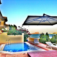 Photo taken at Palm Jumeirah Frond C by Miss L. on 5/9/2013