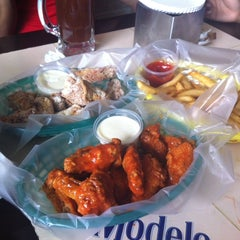 Photo taken at Wings City by Gaby V. on 2/21/2014