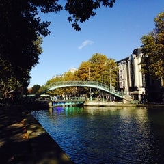 Photo taken at Canal Saint-Martin by Anna🌟 D. on 11/4/2013