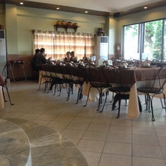 Photo taken at Rustica Restaurant by Xaviery S. on 10/22/2014