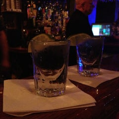 Photo taken at Tanqueray's Bar & Grille by Erin L. on 5/5/2013