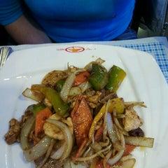 Photo taken at Wok Sushi by Nicola B. on 5/10/2013