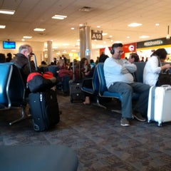 Photo taken at Gate A10 by kwesi k. on 12/21/2014