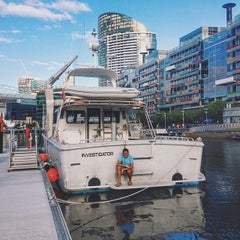 Photo taken at Watermark Docklands by Zac Z. on 12/6/2013