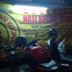 Photo taken at Angkringan Nasi Kucing Fatmawati by Dita R. on 1/4/2014