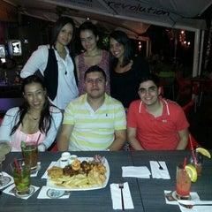 Photo taken at Revolution Cevicheria y cocina peruana by Gloria R. on 1/18/2014