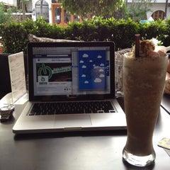 Photo taken at Natureza Deli Café by Chris O. on 10/8/2012