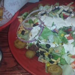 Photo taken at Red Robin Gourmet Burgers by Brittany Nicole L. on 5/25/2013