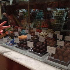 Photo taken at Godiva Chocolatier by Ali G. on 6/1/2013