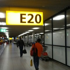 Photo taken at Gate E20 by Aman F. on 3/1/2013
